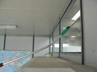 Window cleaning with extension pole and angle adaptor